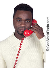 Attractive african man with a red phone