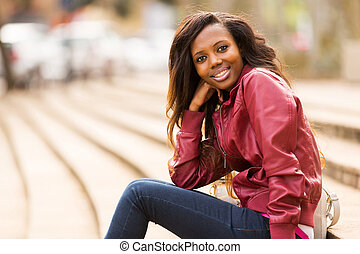 african woman relaxing in urban city