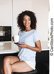 Attractive african woman using mobile phone