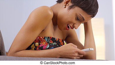 Attractive african woman using smartphone