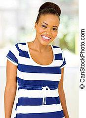 african woman wearing a dress
