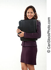 Attractive asian american businesswoman carrying briefcase