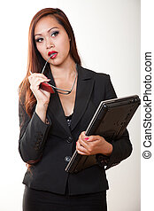 Attractive asian american businesswoman in suit