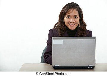 Attractive asian american businesswoman on computer