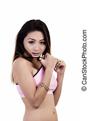 Attractive Asian American Woman Pink Top Pulling On Straps