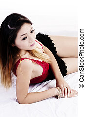 Attractive Asian American Woman Reclining In Red Top