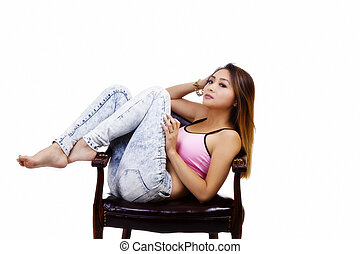 Attractive Asian American Woman Sitting In Chair
