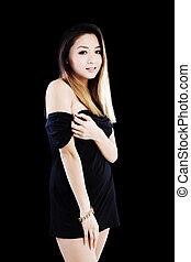 Attractive Asian American Woman Standing In Black Dress