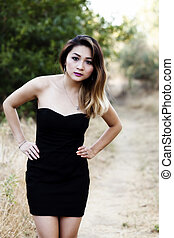 Attractive Asian American Woman Standing Outdoors Black Dress