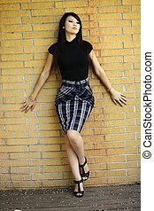 Attractive Asian American Woman Stylish Skirt Standing