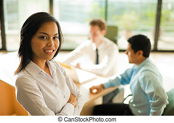 Attractive Asian Business Woman Stands Meeting - An...