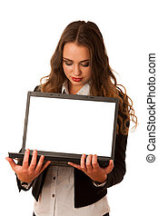 Attractive asian caucasian woman holding a laptop in her hands w