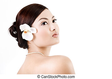 Attractive asian female relaxing after beauty therapy