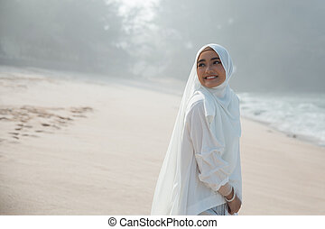 attractive asian muslim woman smiling