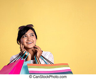 shopping woman looking up to copyspace