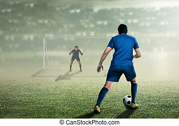 Attractive asian soccer player on the match