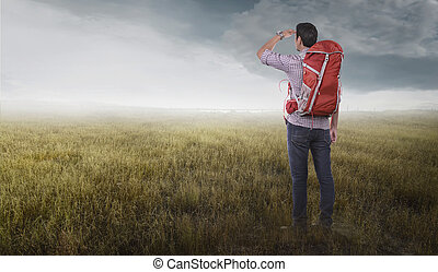 Attractive asian traveler man with backpack looking at landscapes