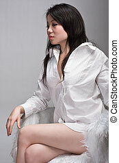 attractive asian woman in chair
