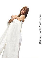 Attractive Asian woman in white dress on white