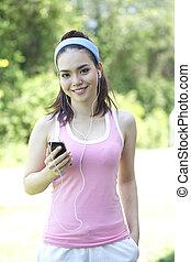 attractive asian woman jogging