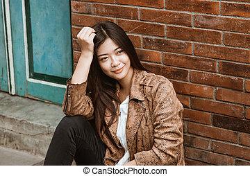 woman portrait smiling wearing brown jacket