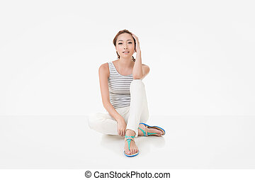 Attractive asian woman sit on ground