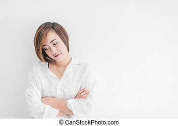 attractive asian woman thinking on wall.