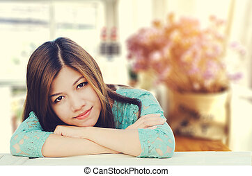 attractive asian woman with smiling at home