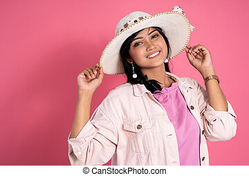 attractive asian woman with summer hat