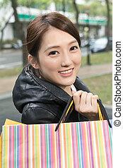 Asian young woman shopping