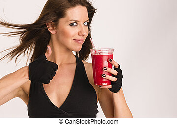 Attractive Athletic Female Shows Thumbs up Sign Holding Refreshing Blended Food Fruit Smothie Drink