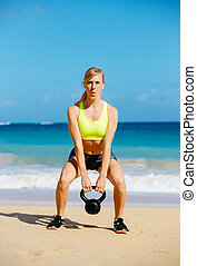 Attractive Athletic Woman Doing Kettle Bell Workout - Young ...