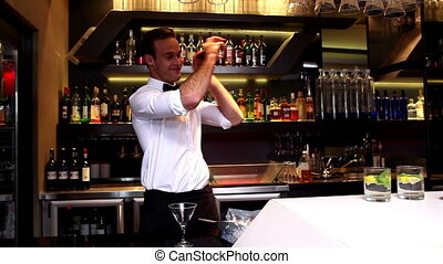 Attractive bar man making