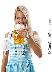 attractive bavarian woman with a beer
