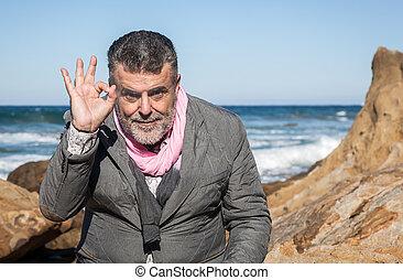 Attractive bearded man on the beach