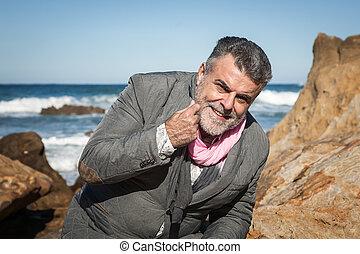 Attractive bearded man on the seashore