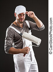 painter in white dungarees and hat - Attractive bearded...