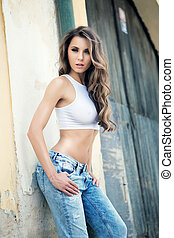 attractive beautiful girl in blue jeans