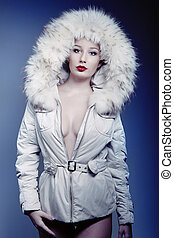 attractive beautiful girl in winter jacket with fur