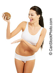 Attractive beautiful woman holding cocnut.