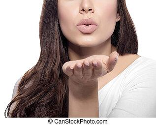 Attractive beautiful woman showing air kiss.