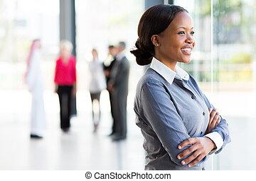 black businesswoman looking outside window