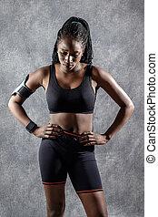 Attractive Black teen girl in sportswear.