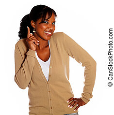 Attractive black woman pointing up and looking you
