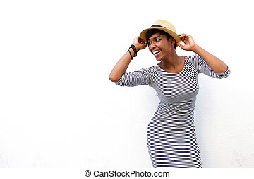 Attractive black woman smiling with hat