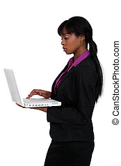 attractive black woman using laptop isolated on white