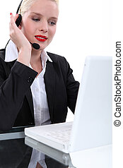 Attractive blond call-centre worker