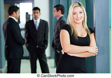 attractive blond corporate worker in office