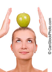 Attractive blond girl with an apple on her head