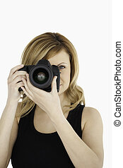 Attractive blond-haired woman taking a photo with a camera